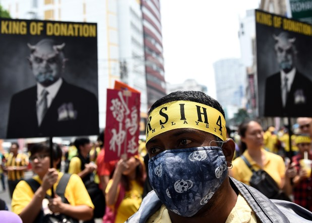 Malaysian protesters rev up second day of rallies against PM