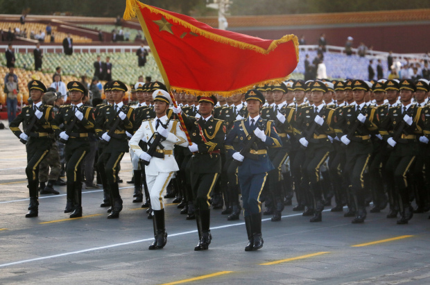 China holds massive military parade, to cut troop levels by 300,000