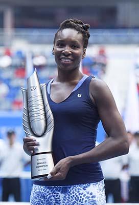 Venus lifts crown as Muguruza quits