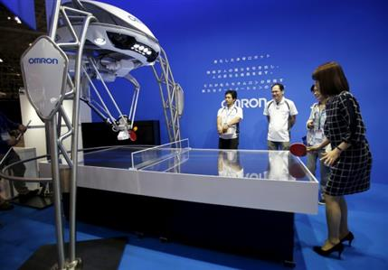 A ping pong robot & a mirror that really doesn't lie, unveiled in Japan