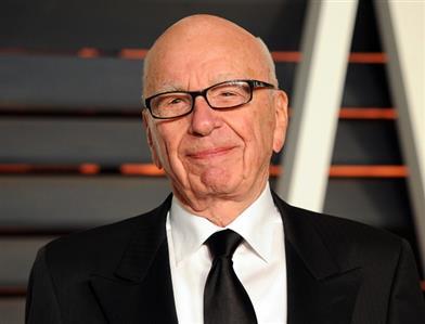 Murdoch says sorry for 'real black president' tweet