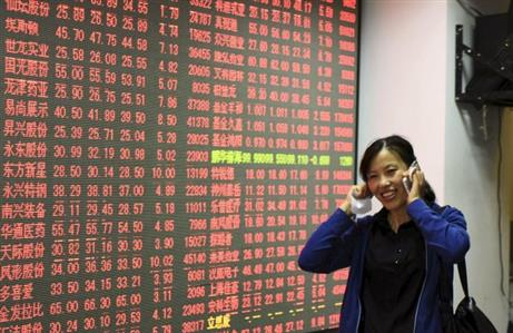 China stocks rise on cautious Fed rate view