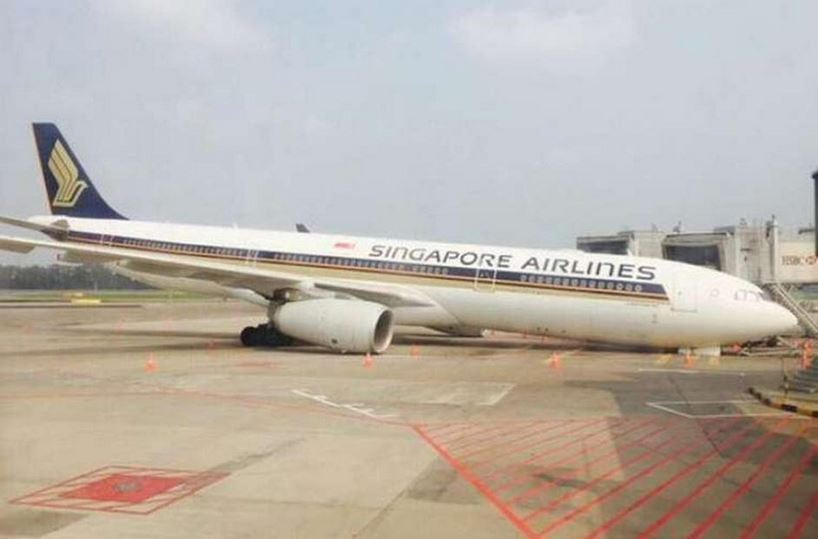 Photos: Singapore Airlines jet collapses during landing checks