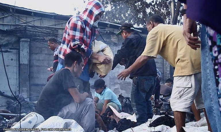 Philippines market fire kills 15, report says