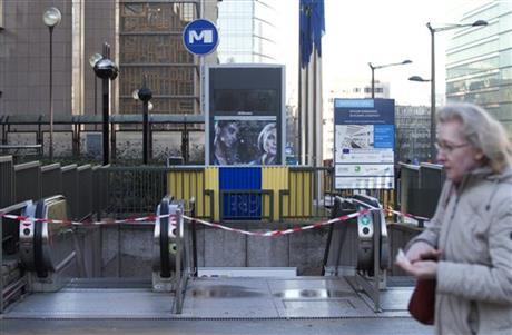 Belgium police arrest 16, Paris fugitive still at large