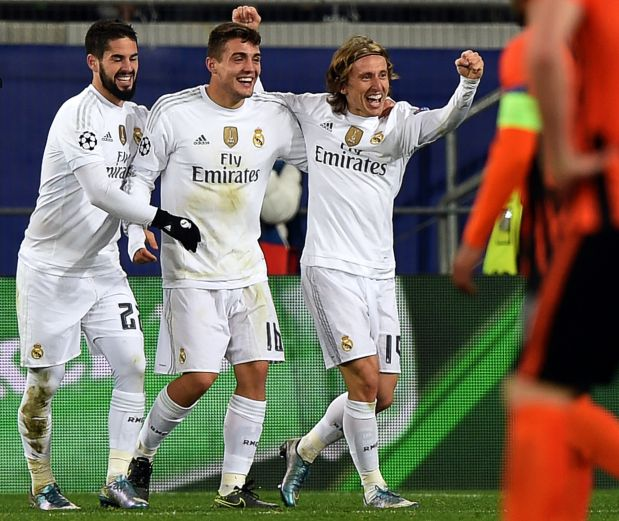 Four-goal Real survive Shakhtar rally to wrap up top spot