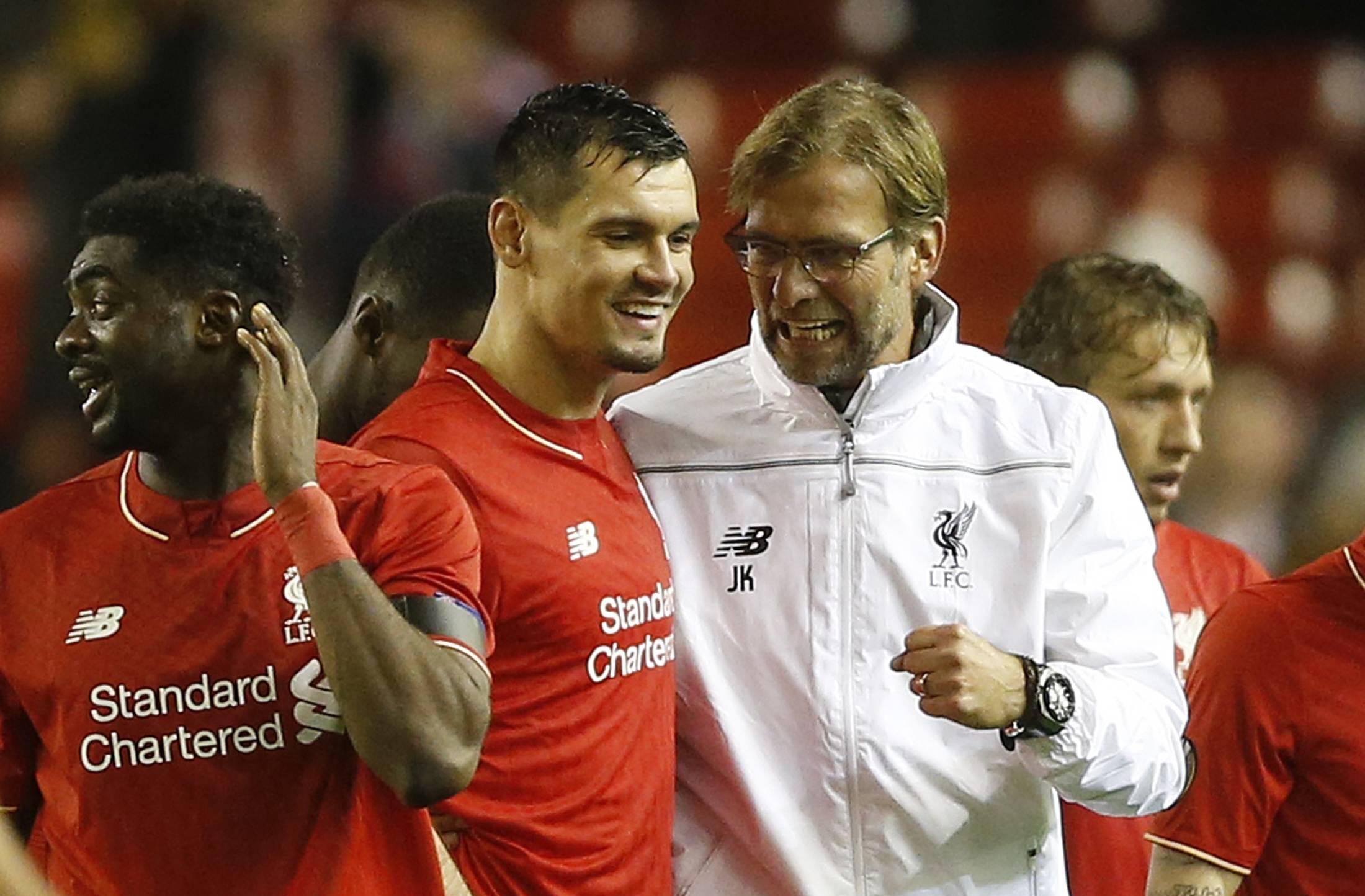 Liverpool and Tottenham advance