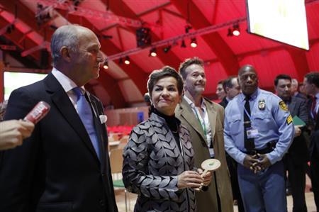 Negotiators vow to honour Paris victims with climate deal