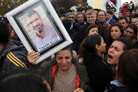 Thousands mourn Kurdish lawyer shot dead in Turkey