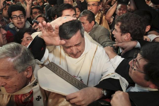 Chilean alleges sex abuse cover-up, asks pope to sack bishop