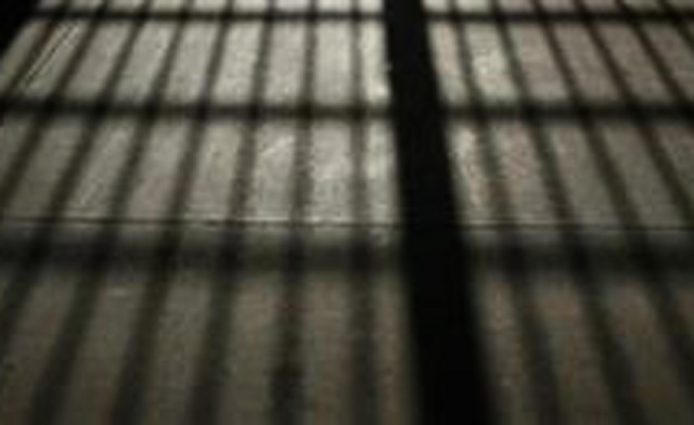 Four jailed for attacking police