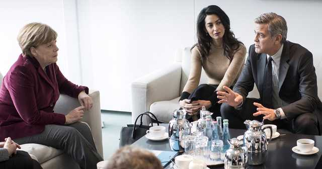 George and Amal Clooney meet Angela Merkel to discuss refugee crisis