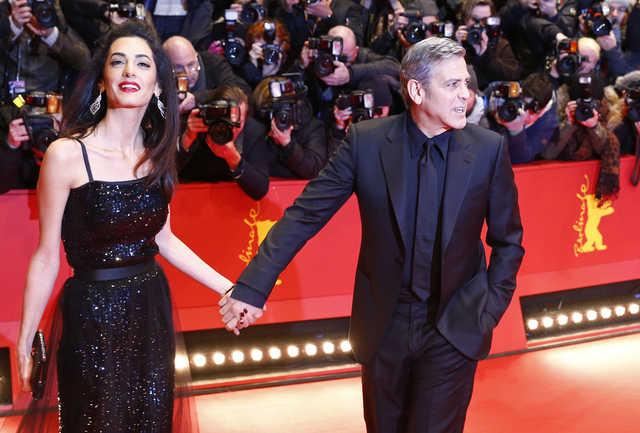 Clooney says refugee crisis is huge, U.S. Muslim ban won't happen