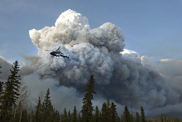 In Pics: Alberta declares emergency as fires threaten Canada oil town