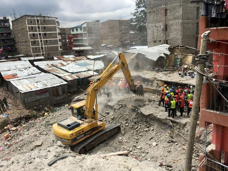 Kenyan rescuers race to free woman trapped under rubble for six days