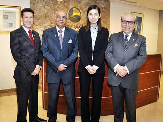 At The Gulf Hotel Are From Left Ghg Deputy Chief Executive Garfield Jones Mr Raees Ms Zho And Bahrain General Manager Rahim Abu Omar