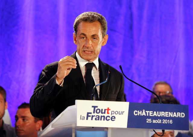 Sarkozy vows nationwide law against Muslim swimwear if elected