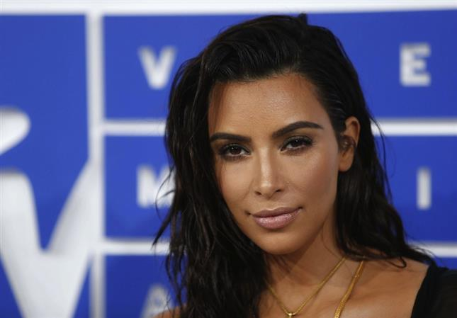 Kardashian needs 'time off' after Paris robbery