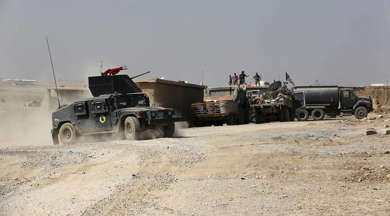 Displaced Christians celebrate as army enters town near Mosul