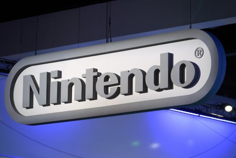 Tokyo stocks up by break, Nintendo dives on new console reveal