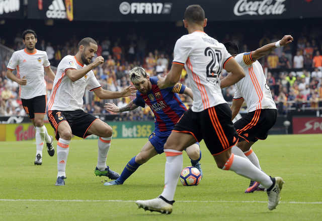Late Messi penalty seals dramatic Barcelona win