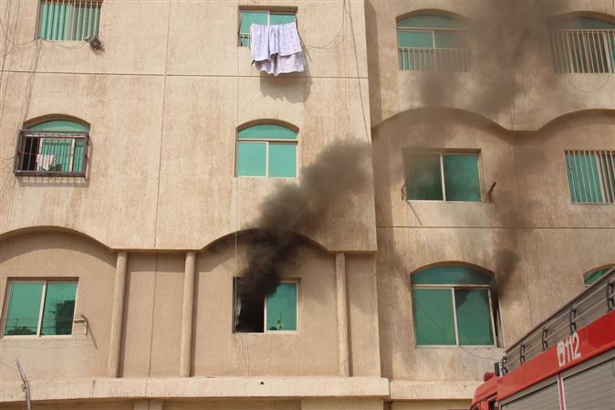 Expatriate woman dies as fire guts building