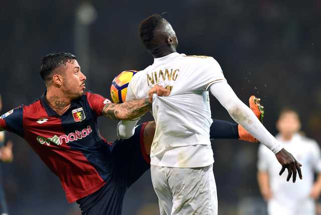 AC Milan wastes a chance to go top in 3-0 loss at Genoa