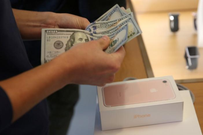 Apple's holiday surprise: big sales, not so big profits