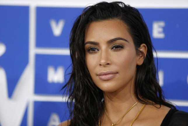 Kim Kardashian resumes filming E! reality TV show after robbery