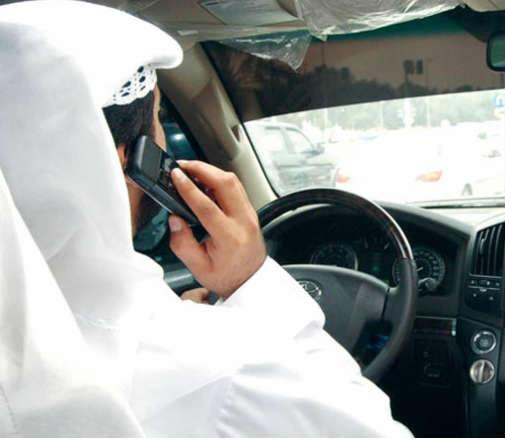People using mobile phones while driving face QR500 fine