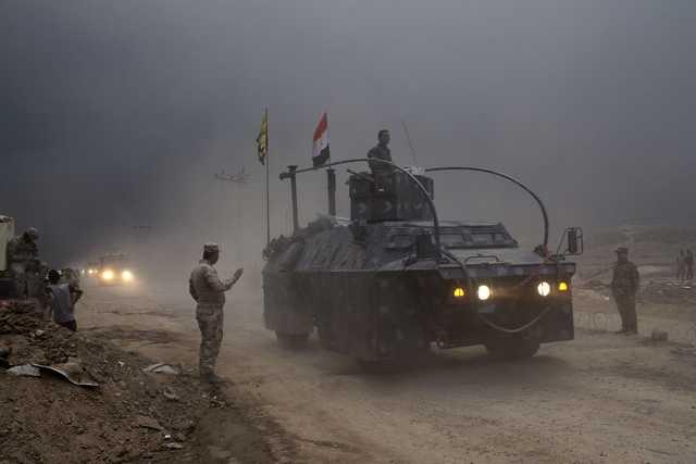 IS executes 232, takes human shields