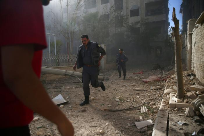 Syrian army says takes Aleppo district, rebels say battle continues