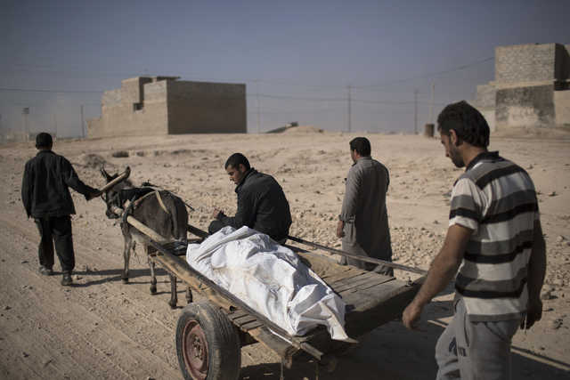 Hundreds of bodies discovered in Mosul mass graves