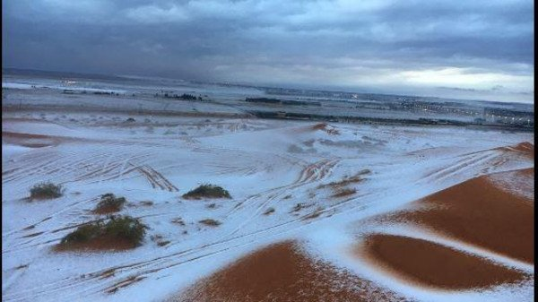 Breathtaking images of snow covering desert sand in Saudi!