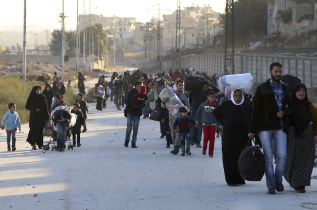 IN PICTURES: Nearly 10,000 civilians flee east Aleppo