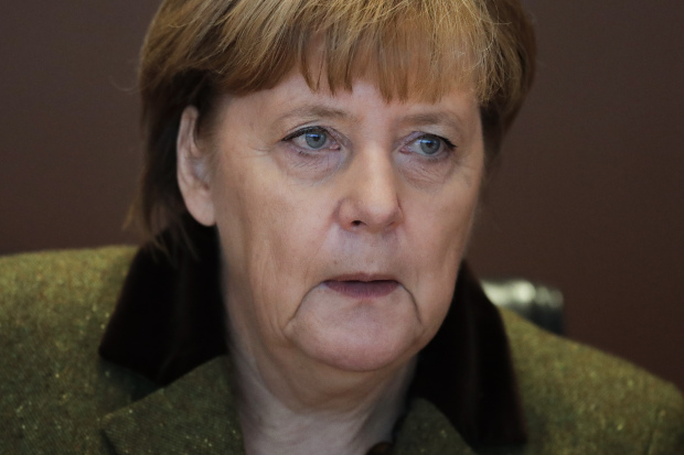 Merkel: from austerity queen to 'leader of free world'