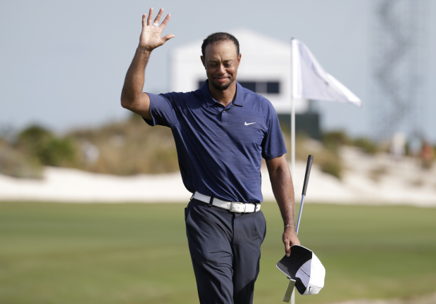 Tiger roars back with bogey-free 65