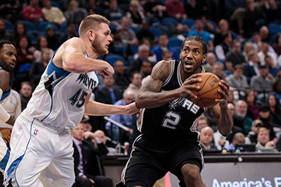 Spurs rally, roll toward history on the road