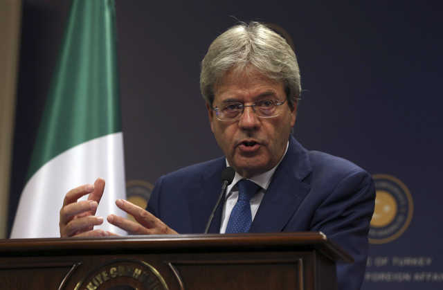Italy president mandates foreign minister to form new government