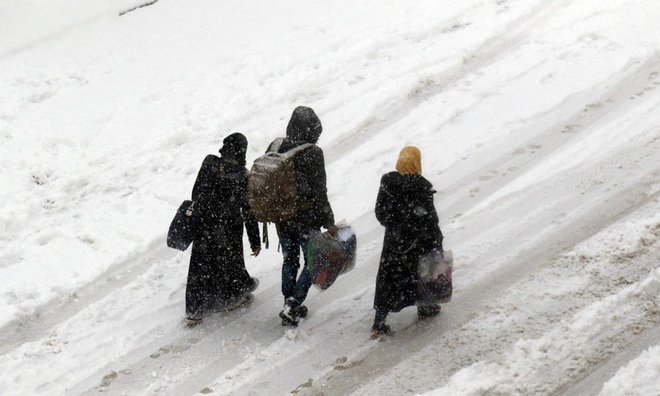 Photos: Aleppo evacuations in heavy snow end brutal war chapter