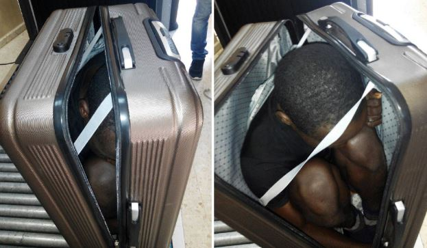 Woman arrested for trying to smuggle migrant in a SUITCASE