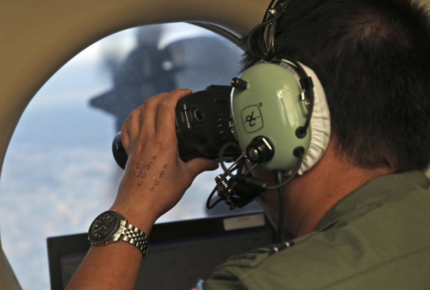 Australia, China, Malaysia say underwater search for MH370 is suspended