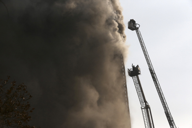 Photos: Collapse of burning Tehran high-rise kills 30 firefighters