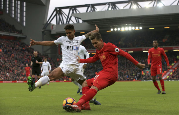 Swansea stuns Liverpool 3-2 to climb off bottom of league