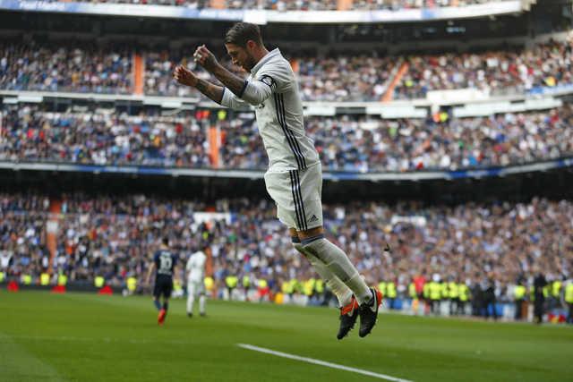Ramos scores twice, keeps Madrid ahead in La Liga