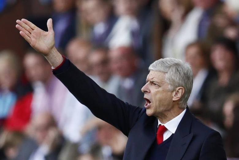 Dismissed Wenger apologises for clash with official