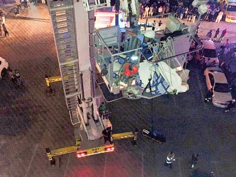 300kg man removed from flat using crane