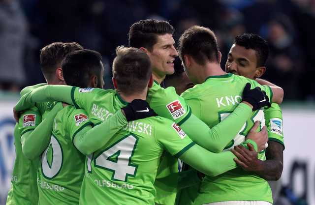 Wolfsburg beats Hoffenheim 2-1 to ease relegation fears