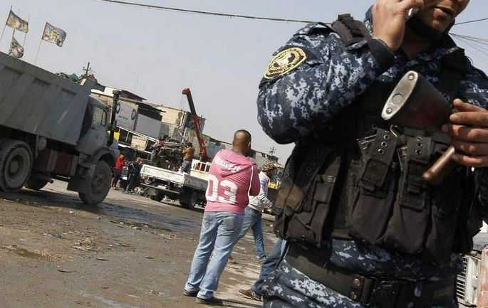 Suicide truck bomber kills at least 15 in Baghdad suburb