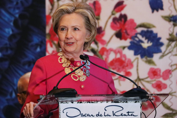Clinton defends immigration to standing ovation in New York